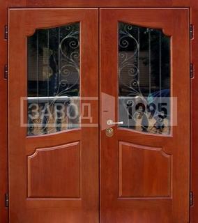 двустворчатые металлические двери с элементами ковки